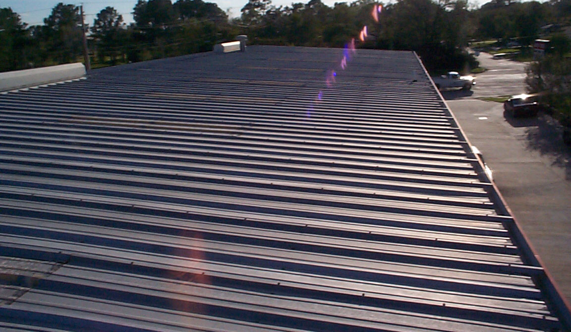 Auto Tech - Friendswood, Texas - Wind & Hail Damaged Metal Roof